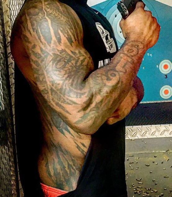 Damien ripped skin tattoo