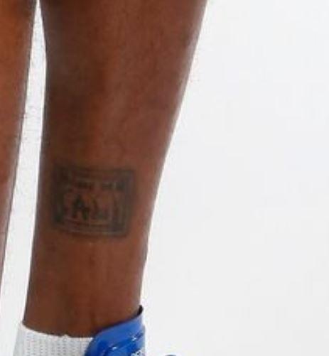 Dorell left leg tattoo