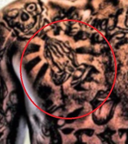 Dorell praying hands tattoo
