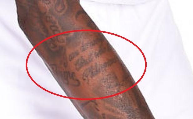 Dorell wriiting tattoo