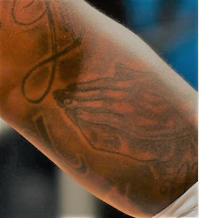 James praying hands tattoo