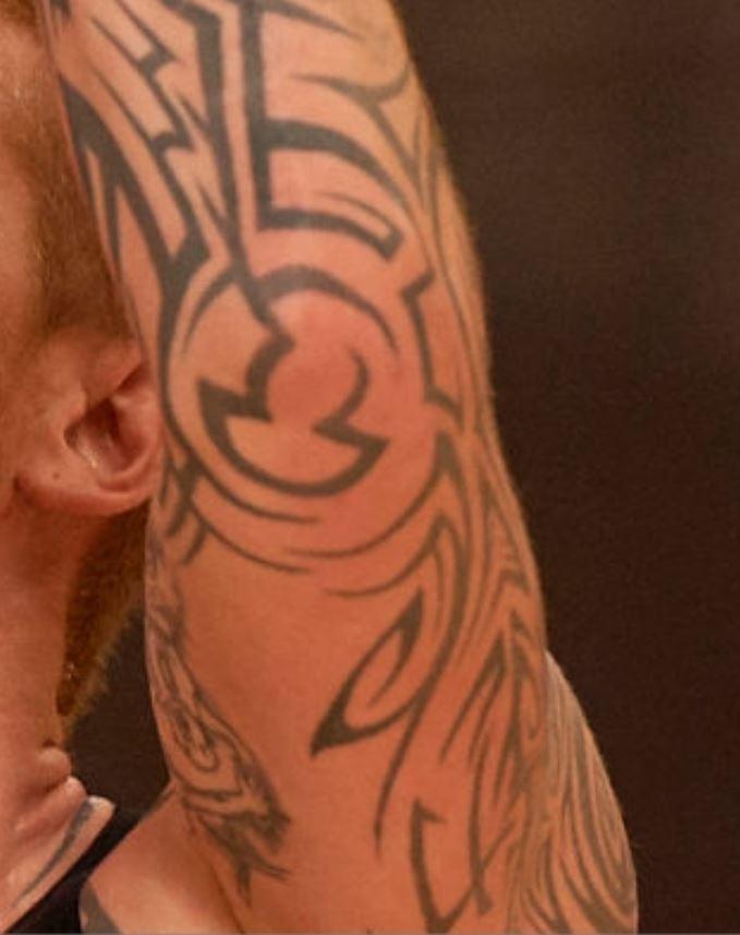 Robert tribal arm tattoo