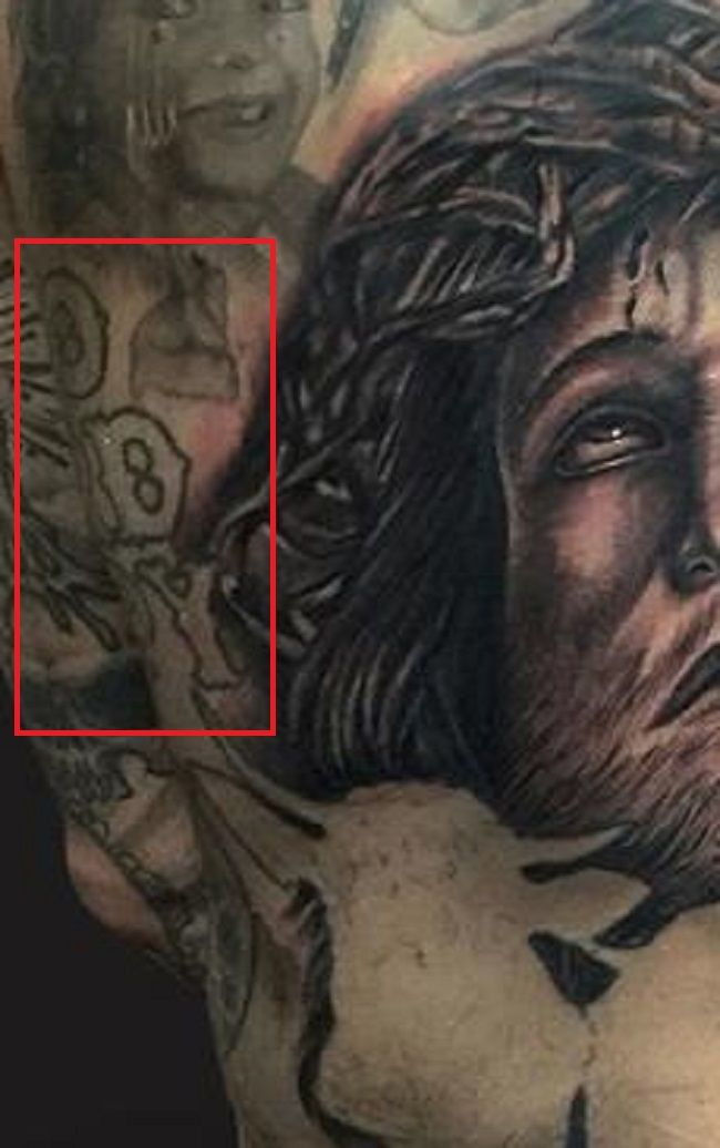 back tattoo of yelawolf