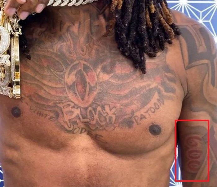 king von left arm tattoo