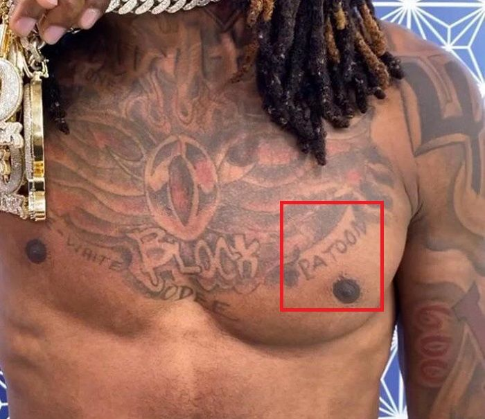king von left pec tattoo