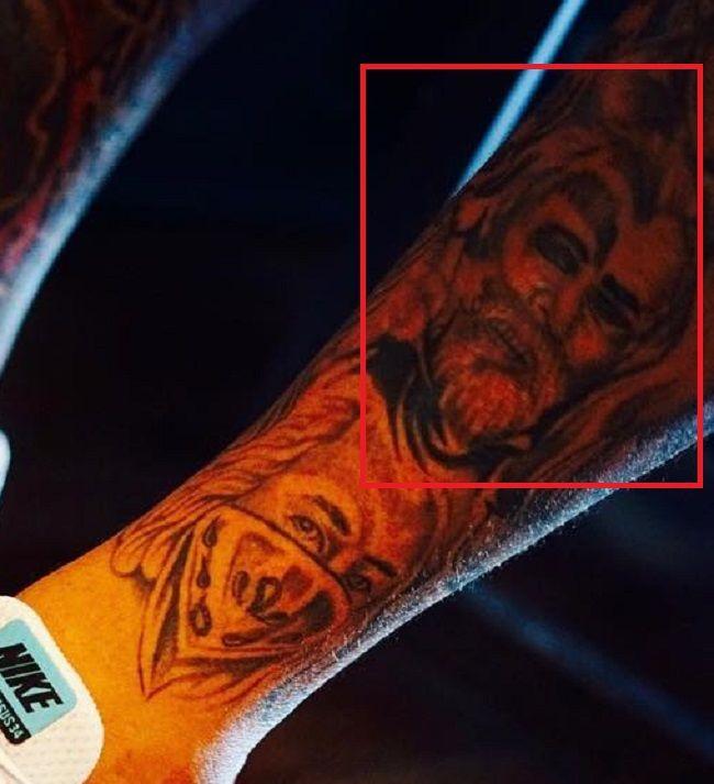 left leg tattooof mike