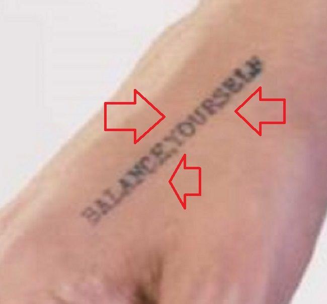 right hand tattoo of logic rapper