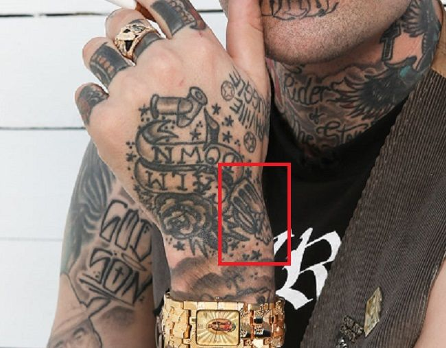 tattoo on left wrist yelawolf