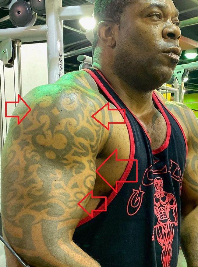 Busta Rhymes-Arm Tattoo