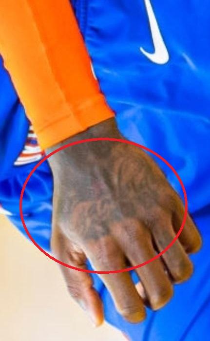 Dennis hand tattoo