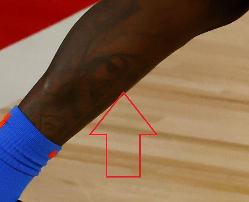 Dennis portrait on leg tattoo