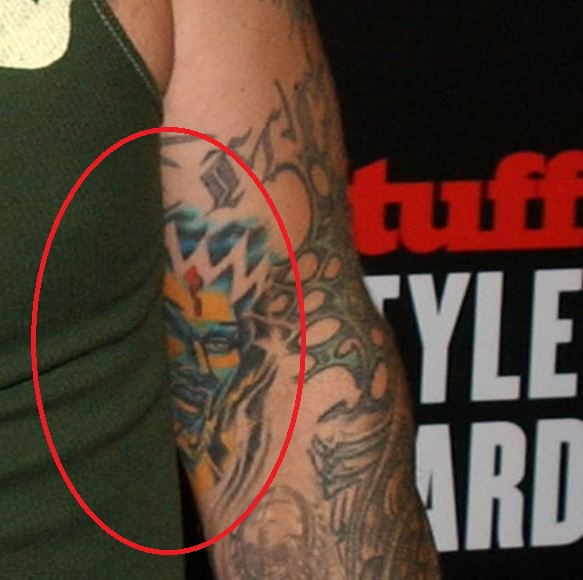 Fred bicep face tattoo
