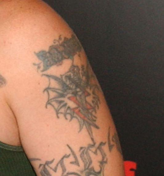 Fred bicep tattoo