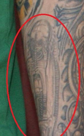 Fred skull on arm tattoo