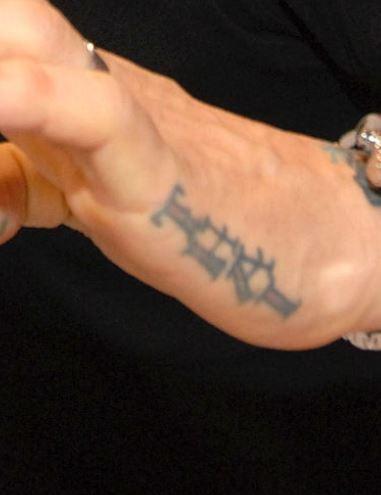 Jason left hand tattoo