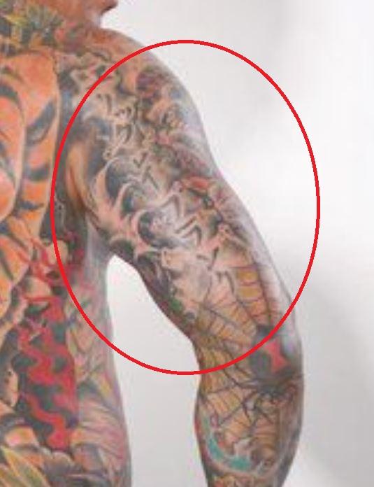 Jason writing on shoulder tattoo