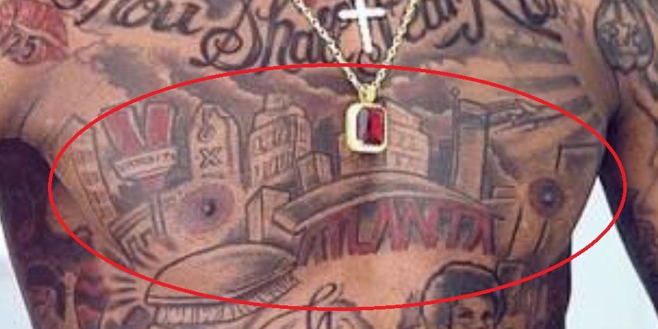 Quan chest tattoo