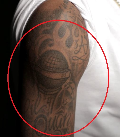 Quan righ bicep microphone tattoo