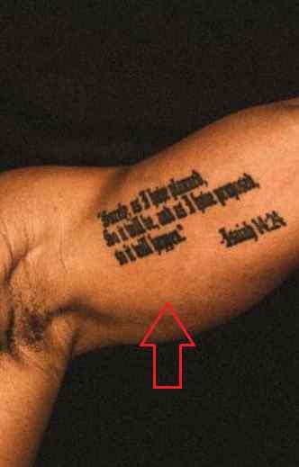 Rotimi bicep tattoo