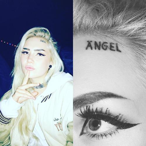 angie-angel-forehead-tattoo