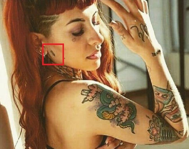dollar sign tattoo of cazzu