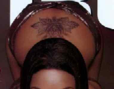 Brandy Norwood flower tattoo