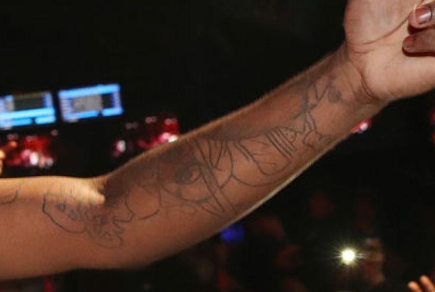 Chief left inner arm tattoo