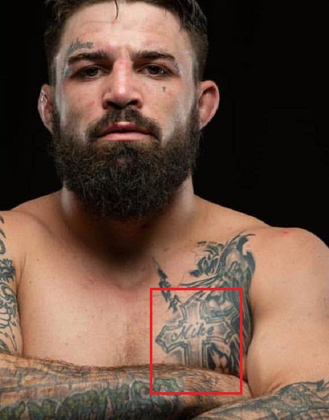 Cross Tattoo-Mike Perry