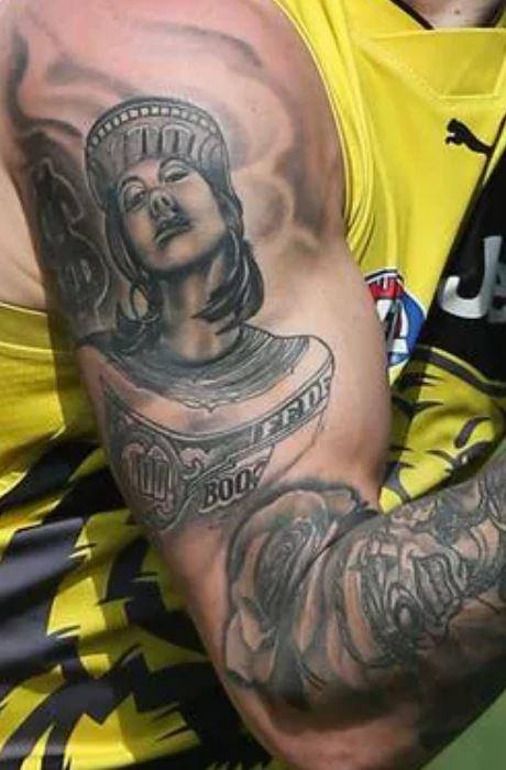 Dustin bicep tattoo