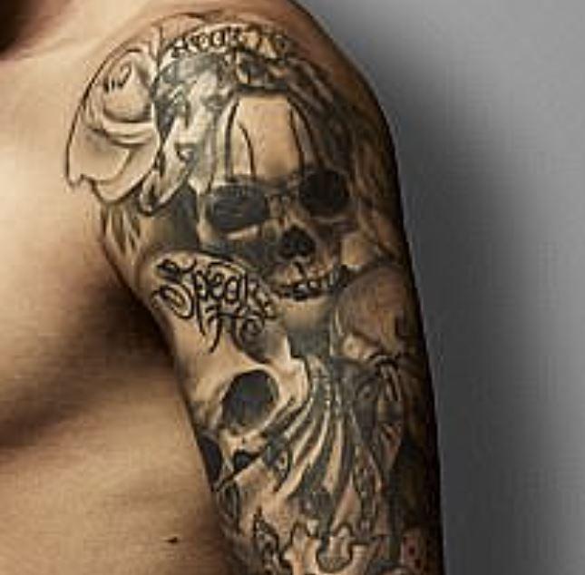 Dustin skull and rose tattoo