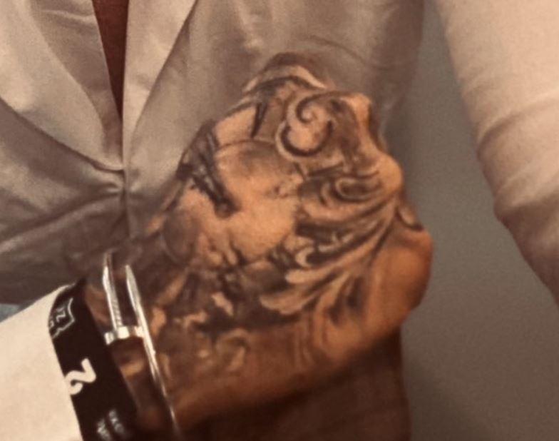 Ethan right hand tattoo