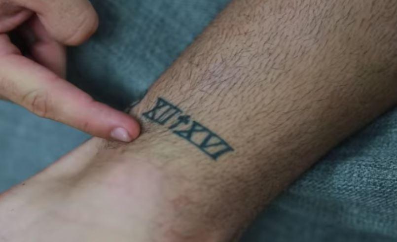 Ethan roman numerals tattoo