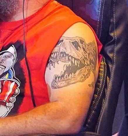 Kevin Owens dinosaur tattoo