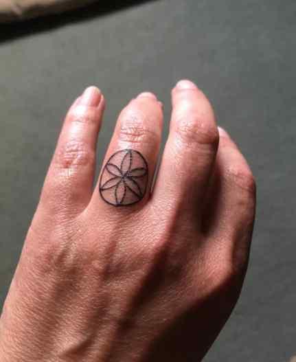 Melissa Harrison flower tattoo