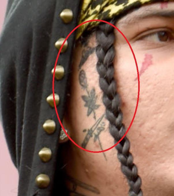 Sosmula face tattoo