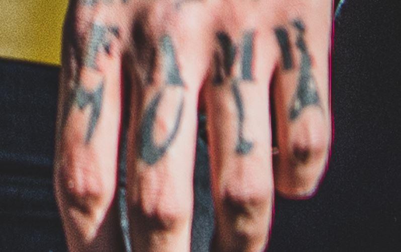 Sosmula left hand tattoo