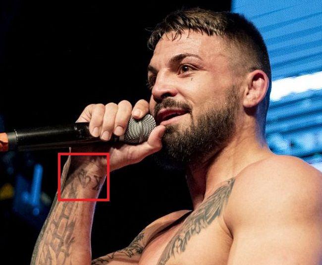 wrist tattoo of mike perry