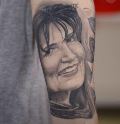 Adriel portrait tattoo on left arm