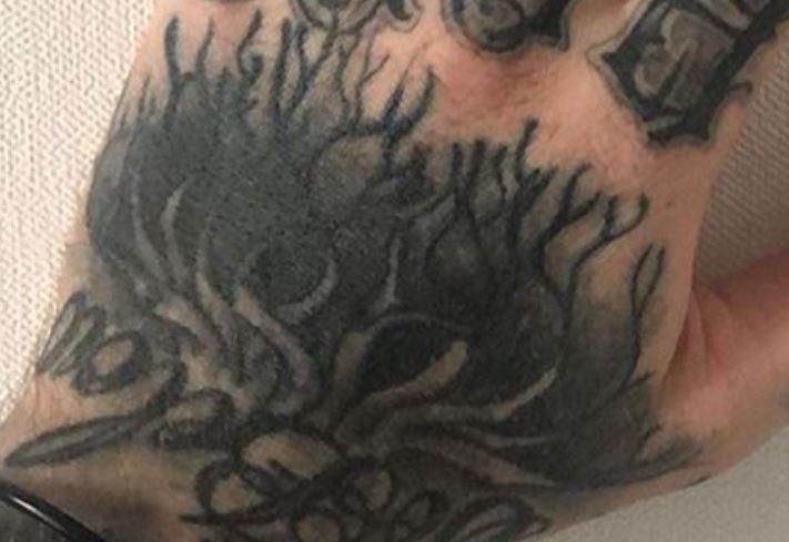 GHOSTEMAN left hand tattoo