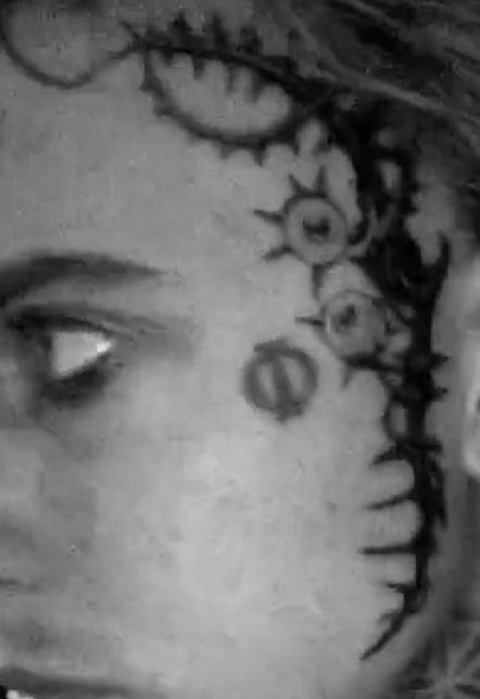 GHOSTEMANE left face tattoo