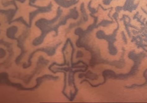 JID cross tattoo