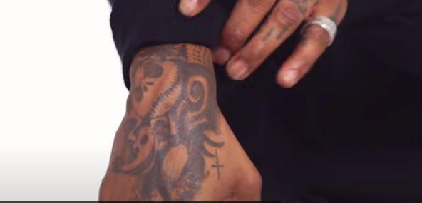 JID hand nightmare tattoo