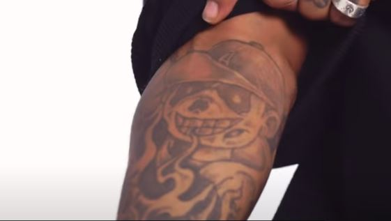 JID self portrait tattoo