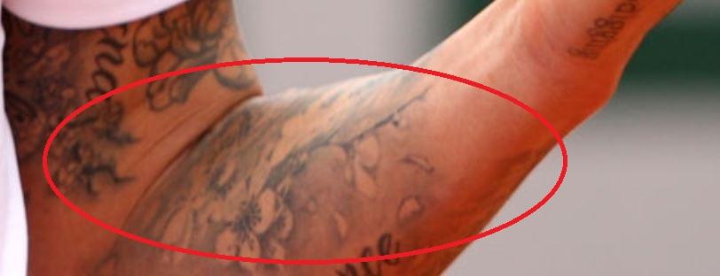 Janko flowers on arm tattoo