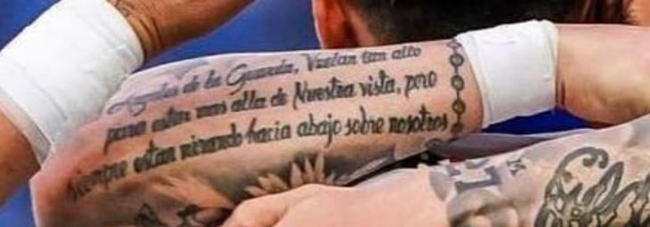Mauro writing on aforeram tattoo