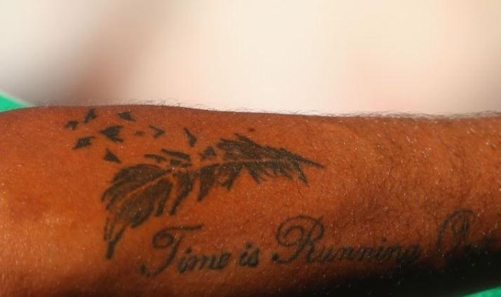 Nick feather tattoo