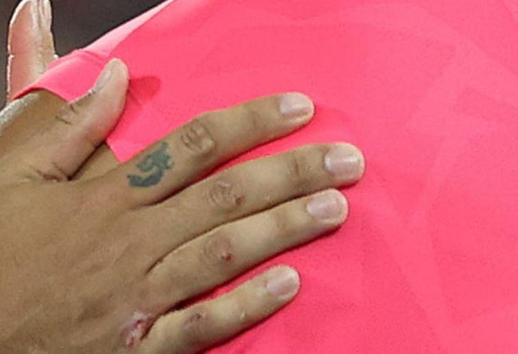 Nick finger tattoo