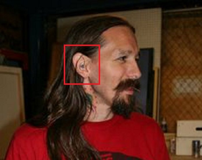 OLiver Peck-Ear Tattoo