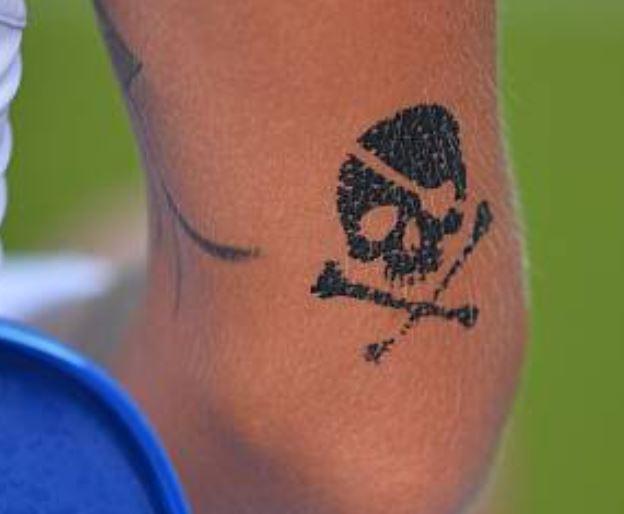 Polona skull crossbones tattoo