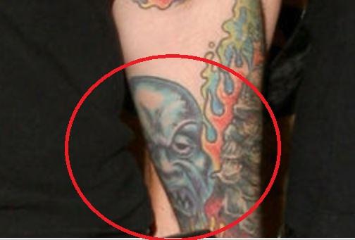 Rob left arm tattoo